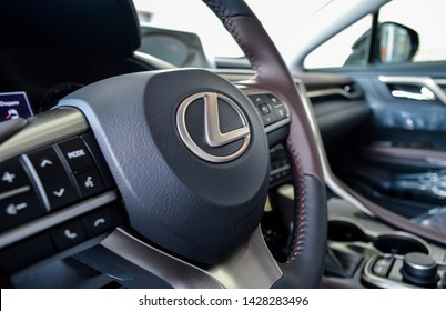Yerevan, Armenia - 18 June 2019. Lexus RX350's black and brown dashboard with leather steering wheel with metal Lexus emblem on it.