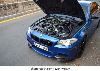 Yerevan, Armenia - 21 September 2018. Crazy blue BMW M5 with opened hood. You can see huge powerful V8 engine with 560 horsepower.