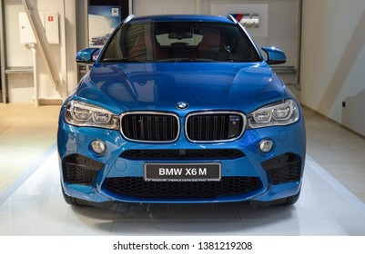 "Yerevan, Armenia - 25 April 2019. Long beach blue BMW X6M standing at BMW Armenia showroom near another BMW models. You can see big ""M"" logotype at background."
