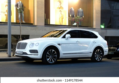 Yerevan, Armenia - 28 May 2017. One of the most luxurious SUV in the world! Pearl white Bentley Bentayga under street lights