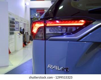 Yerevan, Armenia - 29 January 2019. All-new compact crossovers Toyota RAV4 premier at Toyota Yerevan dealership showroom. Black and grey cars.