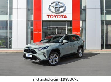 Yerevan, Armenia - 29 January 2019. All-new compact crossovers Toyota RAV4 premier at Toyota Yerevan dealership showroom. Grey car standing next to showroom entrance.