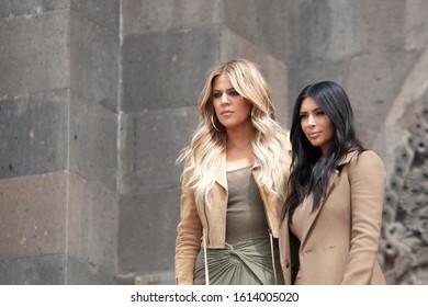 YEREVAN, ARMENIA - APRIL 09, 2015 U.S. reality TV star Kim Kardashian (R) and her sister Khloe Kardashian (L) pose for a photo as they take a walk through sightseeing the city
