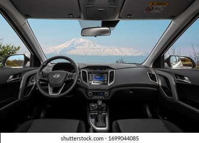 Yerevan, Armenia - April 09, 2020: Hyundai Creta  (also known as Hyundai ix25) Korean compact crossover interior with Ararat mountain in windshield. Close-up of the dashboard. Wide angle view