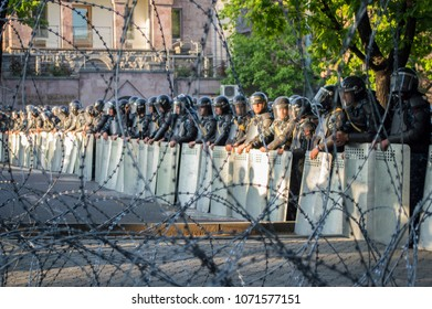 Yerevan, Armenia - April 16, 2018: Police behind barbed wires blocks Baghramyan avenue in Yerevan amid protests against appointing former president Serzh Sargsyan as prime minister of Armenia
