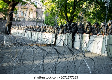 Yerevan, Armenia - April 16, 2018: Police blocks Baghramyan avenue in Yerevan amid protests against the government's decision to appoint former president Serzh Sargsyan as prime minister of Armenia