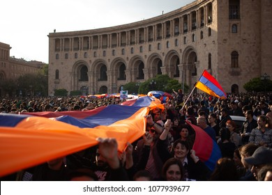 Yerevan, Armenia - April 22 2018: Protesters holding huge Armenian flag on Republic Square during a rally against Prime Minister.