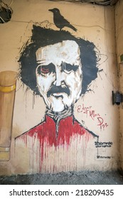 YEREVAN, ARMENIA, JULY 28, 2014. A graffiti of the poet Edgar allan Poe with a crow sitting on his head in Yerevan, Armenia, on July 28th, 2014