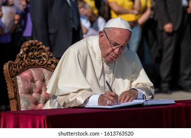 YEREVAN, ARMENIA - JUNE 25, 2016  Pope Francis writes a note in the Honorable Visitors' Book, during his visit to the Tsitsernakaberd Armenian Genocide Memoril