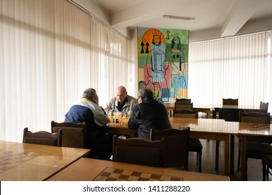Yerevan, Armenia, March 2018: Two men play chess inside the Chess House of Yerevan. Chess is considered the National sport in Armenia, and is played by the elder as much as by young children.
