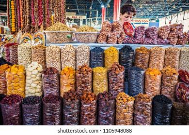 YEREVAN, ARMENIA - May 2018: Tashir market in Yerevan, big choice of dry fruits on the counter, Armenian woman selling dry fruits and nuts on the market, Yerevan, Armenia