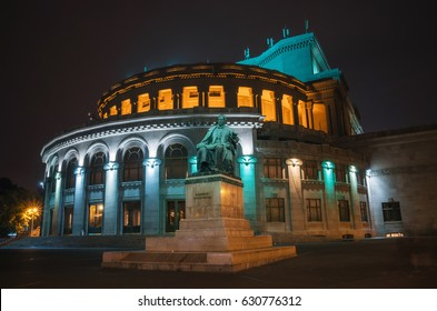 Yerevan, Armenia - October 24, 2016: National Academic Theatre of Opera and Ballet named after Alexander Spendiaryan of Armenia illuminated at night. Composer Spendiaryan statue.