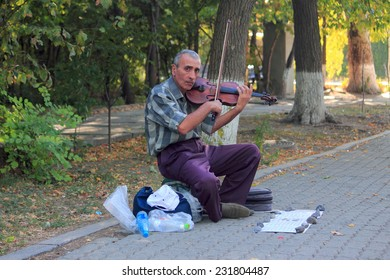 YEREVAN, ARMENIA - SEPTEMBER 16, 2013: street violinist plays his instrument on pedestrian street in Yerevan, Armenia on 16th September, 2013