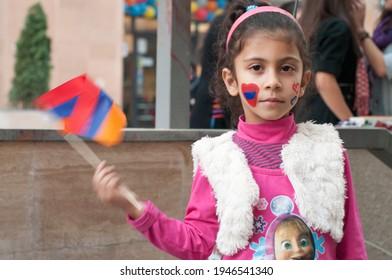 Yerevan, Armenia, September 2012: A little girl waving an Armenian flag   during Yerevan Anniversary celebrations.