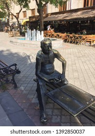 Yerevan, Armenia, September 2018: Sculpture of Backgammon Player in what  on Gevorg Kotchar Street. The sculpture was created in bronze and placed in an area where backgammon players are often found.