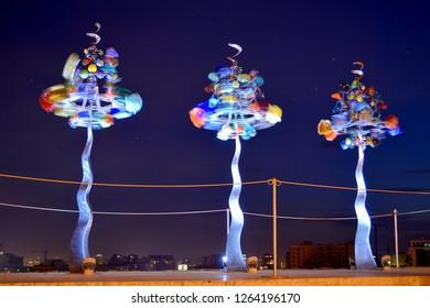 YEREVAN, ARMENIA - September 21,2018:rotating  The weathervane trees with glass flowers of Yerevan cascade at nigh.