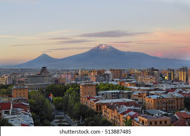 Yerevan in Armenia and the two peaks of the Mount Ararat at the sunrise.