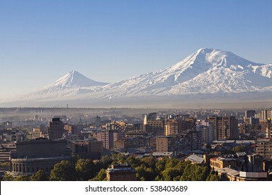Yerevan, capital of Armenia at the sunrise with the two peaks of the Mount Ararat on the background.