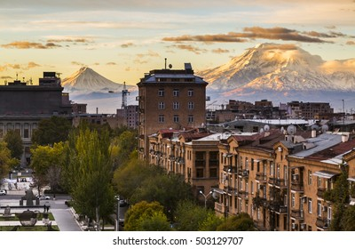 Yerevan city view with Ararat mountain in the background. Sunrise in Yerevan - the capital of Armenia with beautiful biblical Ararat mountain. Old fashioned sepia colors. Post card view.
