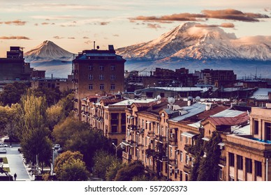 Yerevan City view with majestic Ararat mountain in the background. Sunrise in Erevan - the capital of Armenia. Travel to Armenia, Caucasus. Toned with soft retro style colors.