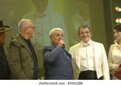YEREVAN - NOVEMBER 11:  Peter Gabriel, Jivan Gasparyan & Dmitry Dibrov (from left to right) during Jivan Gasparyan's 80years celebration evening. November 11, 2008, in Yerevan, Armenia