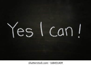 Yes I Can, Motivational Phrase written with Chalk on Blackboard
