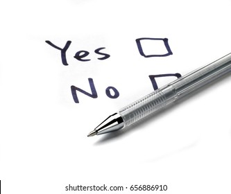 yes and no check boxes on white paper and ballpoint pen