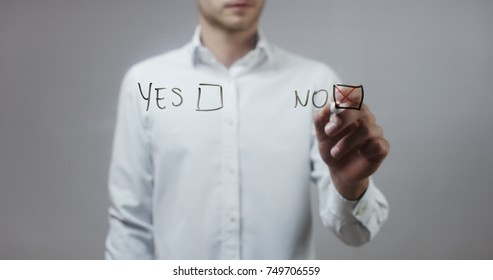 Yes or no, No checked , Man Writing on Glass