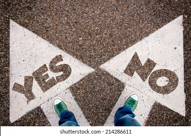 Yes or no dilemma concept with man legs from above standing on signs