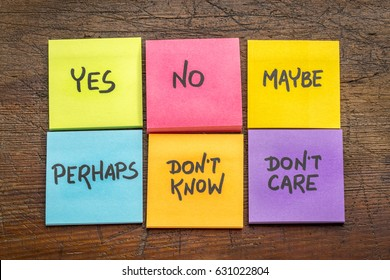yes, no, maybe, perhaps, don't know, don't care -  undecided voter concept, colorful sticky notes against grunge rustic wood board