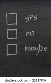 yes, no and maybe voting check boxes sketched with white chalk on blackboard