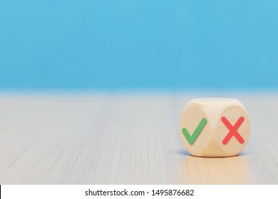 Yes or No symbols on wood blogs cube on blue background.