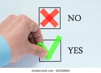 Yes No tickbox with green red tick. Hand holding marker