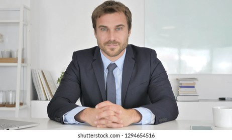 Yes, Positive Businessman Accepting Offer by Shaking Head