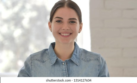 Yes, Positive Young Girl Accepting Offer by Shaking Head