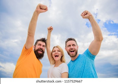 Yes we can. Woman and men look confident successful sky background. Behaviors of cohesive team. Celebrate success. Ways to build ohesive team. Threesome stand happy confidently with raised fists.