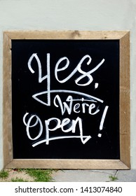 Yes, we are open sign. On outdoor cafe