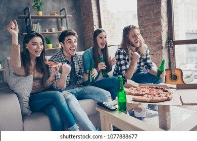 Yes, yeah, hooray, goal! Cheerful excited happy joyful four friends are watching soccer on tv at home drinking alcohol beverages eating takeaway food