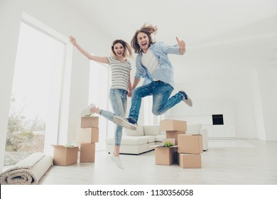 Yes yeah hooray wow! Change improvement success good mood day emotion expressing ownership concept. Full length size photo portrait of joyful cheerful partners jumping up holding hands