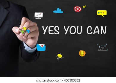 YES YOU CAN Businessman drawing Landing Page on blurred abstract background
