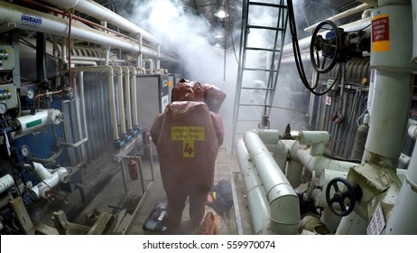 YESUD HAMAALA ISRAEL, MARCH 21, 2016: Firefighters practice sealing of leak accident from corrosive toxic hazardous material Ammonia liquid container in fruit factory dressing protective suites.