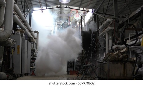 YESUD HAMAALA ISRAEL, MARCH 21, 2016: Toxic corrosive hazardous material Ammonia gas comes out from leaking container accident in fruit factory. Firefighters are on the way