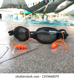 Yet Kieu Swimming Pool, VietNam, 14 July 2017: A photo of swim gogle and ear plugs.