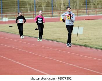 YEVPATORIYA, UKRAINE - MARCH 06: Unidentified girls age 13-14 at the 3,000 meters race walk on Ukrainian Race Walk Track & Field Championships on March 06, 2012 in Yevpatoriya, Ukraine.
