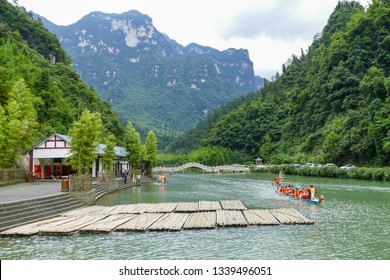 Yichang, Hubei, China, June 3, 2016: People having Dragon boat competition during the dragon-boat festival in picturesque Three Gorges Bamboo Sea Ecology Scenic Spot, Maopingzhen, Zigui