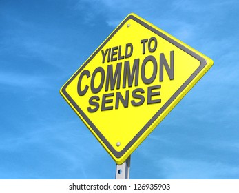 """A yield road sign with """"Yield to Common Sense""""on a blue sky Background."""