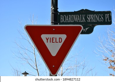"""A yield sign next to a street sign that says: """"Boardwalk springs place."""" Picture taken in O'Fallon, Missouri."""