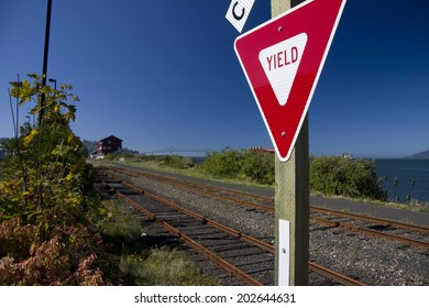 Yield sign at a railroad crossing