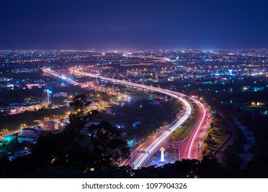 Yilan County Night View - City skyline with car light trails at night in Yilan, Taiwan.