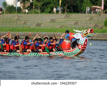 YILAN TAIWAN - JUNE 2: Rowers row their boat. The Dragon Boat Festival on the Dongshan River on June 2, 2014 in Yilan